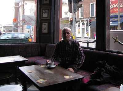Pausing for coffee on the James Joyce trail, with Sweny's chemist in the background