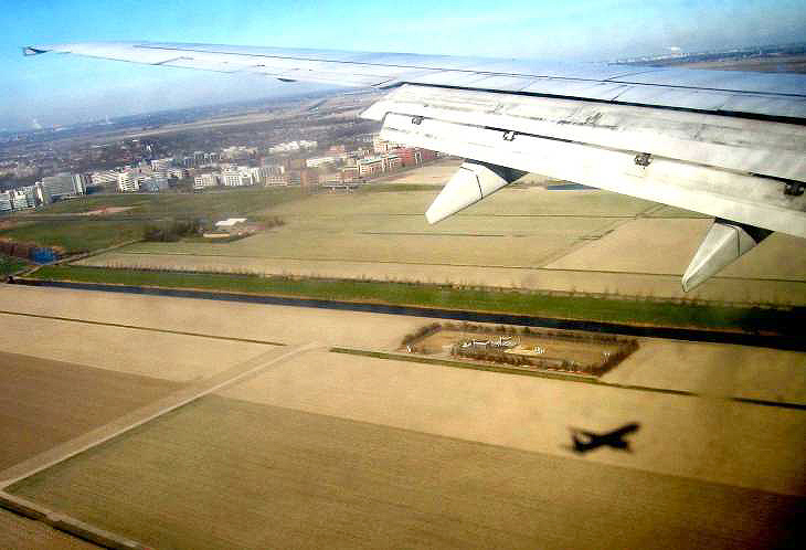 View from aeroplane with plane's shadow, over Holland