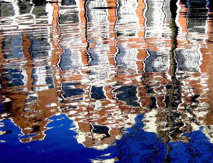 Reflections in water in Amsterdam canal