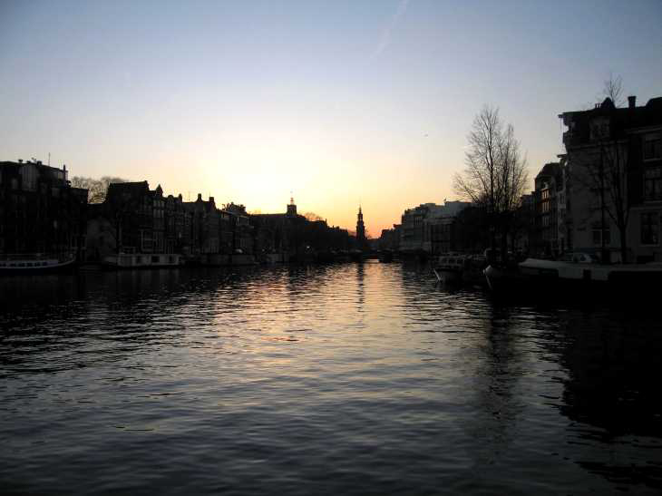 Evening in Amsterdam, Canal at sunset with spire