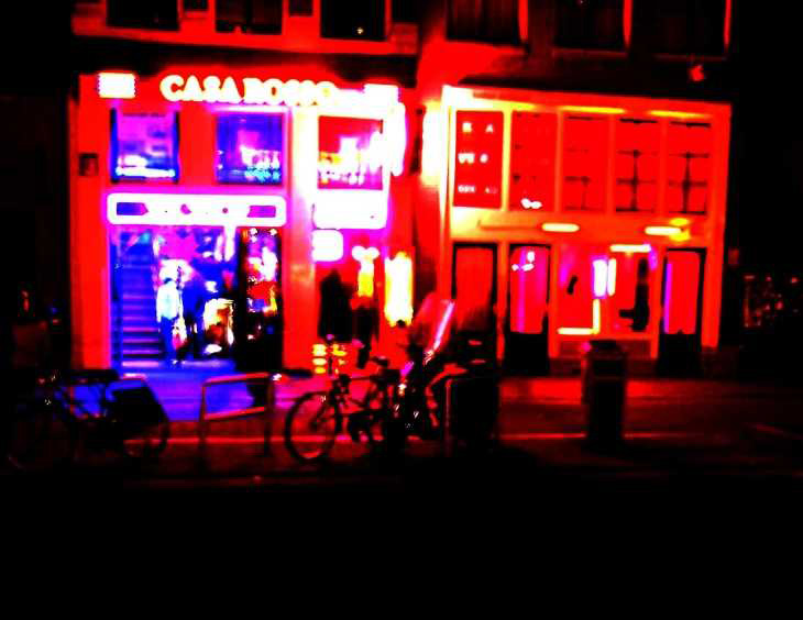 Lurid light in the Amsterdam night. Oudezijds Achterburgwal