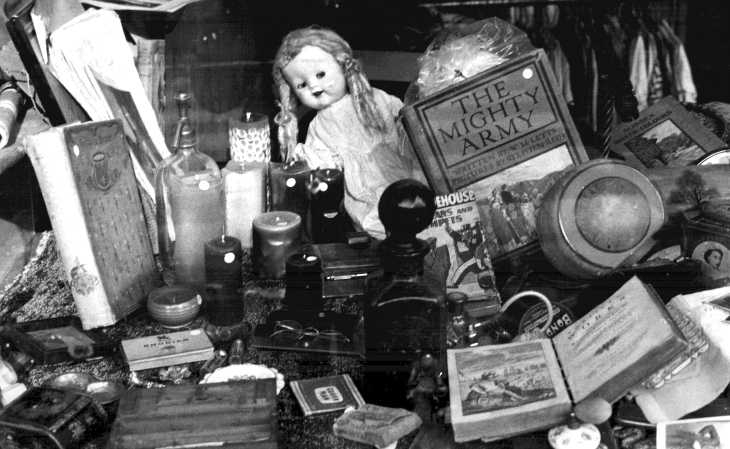 Black and white photograph antique shop window