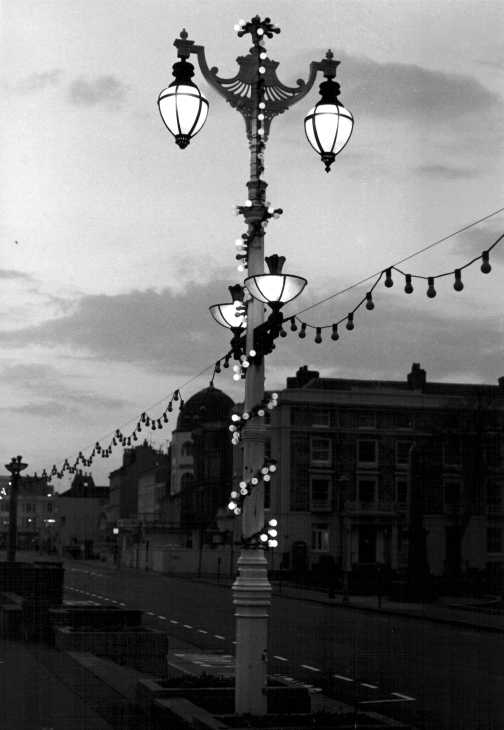 Black and white photograph. Evening lights, south coast