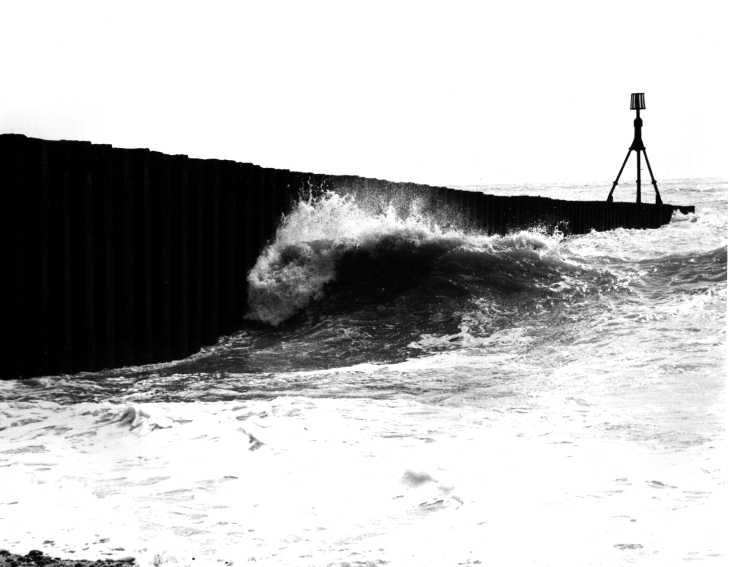 Black & white photograph. Breaking wave