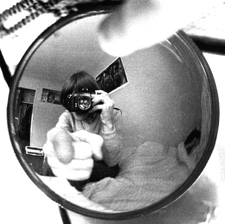 Photographer and curved mirror