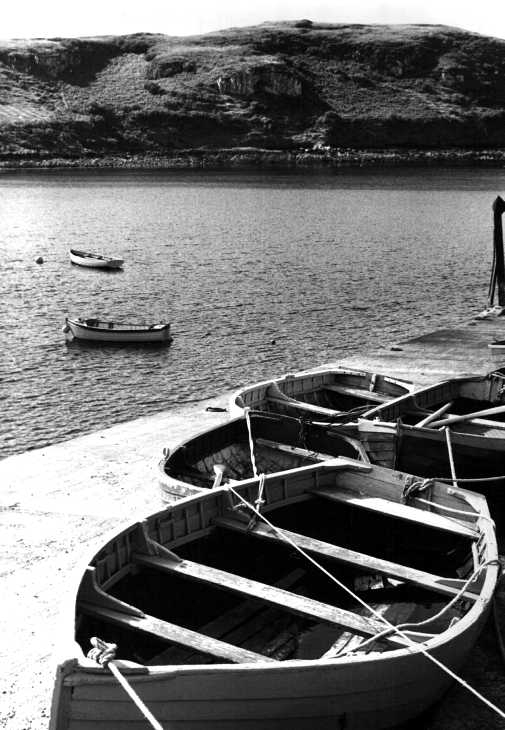 Rowing boats on jetty on The Isle of Skye