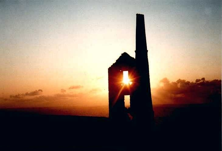Sunset behind tin mine, Cornwall