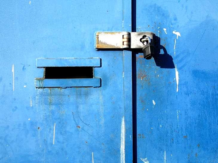 Blue iron door and padlock, London East End