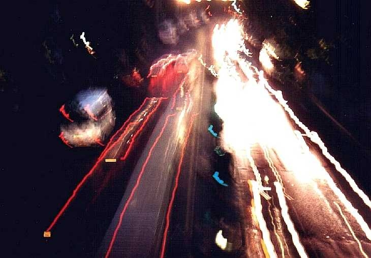 Cars on The Embankment, London at night