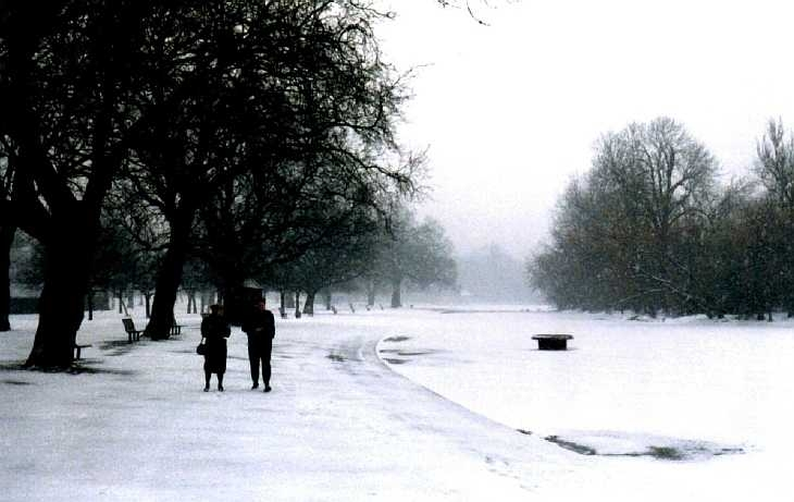 Couple in snow in Regent's Park, London