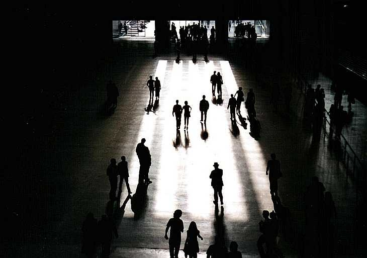 Silhouetted figures at the Tate Modern, London