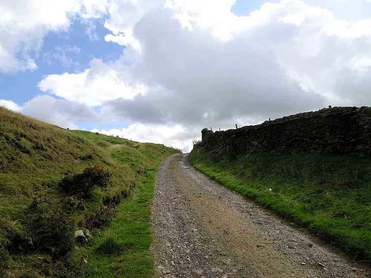 Track and clouds, The Peak District