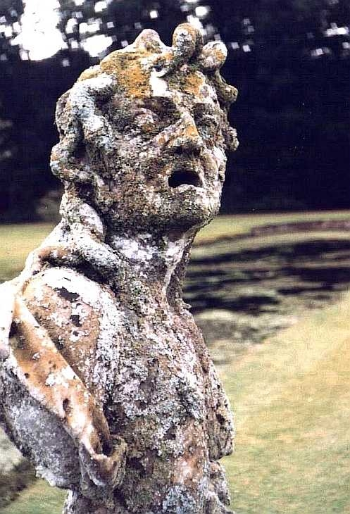 Textures. Stone statue and lichen