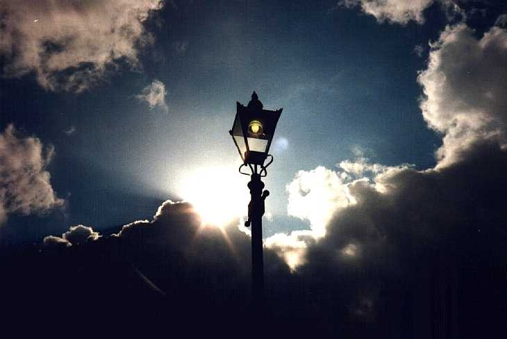 Alexandra Palace, North London, street lamp, sun, and stormy sky