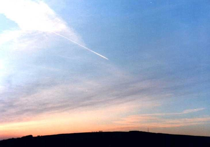 Jet trail in evening sky