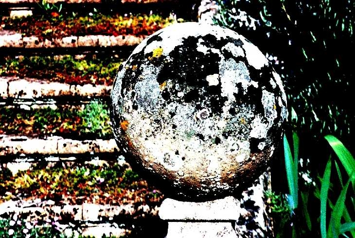 Concrete ball with lichen. Posterization