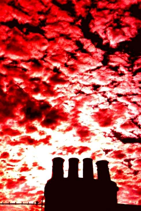 Chimney pots and cloudy sky