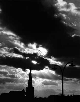 Church spire and stormy sky