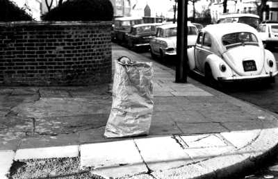 Girl playing in bag, West London