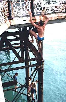 Divers on the pier at Brighton, Sussex