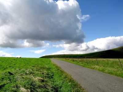 Road, hill and sky