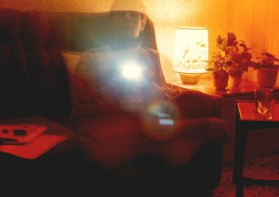 Self-portrait with flash gun, experimental photograph